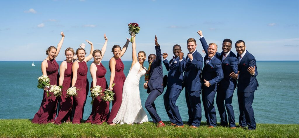 bridesmaids and groomsmen by the lake