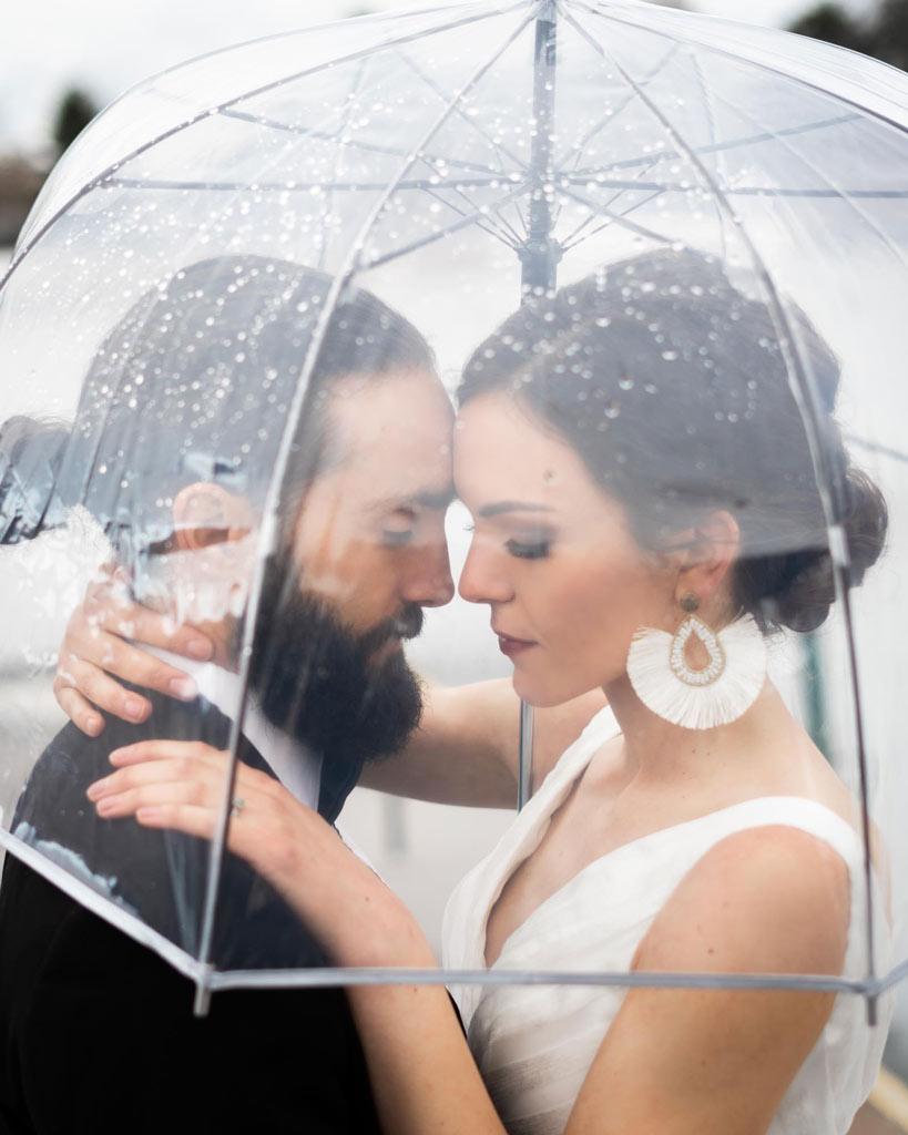 rainy day wedding photography with an umbrella